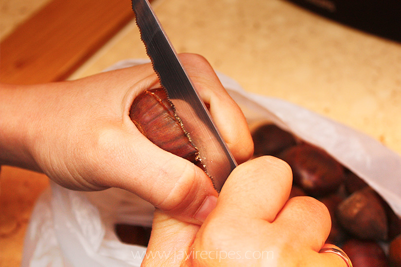 Cutting a chestnut with a sharp knife